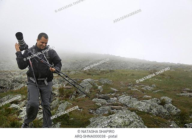 Man With The Camera On The Summit Of Mount Washington During Heavy Cloud Coverage