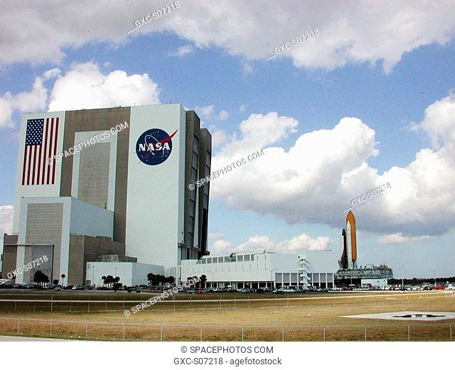 01/19/2001 -- Space Shuttle Atlantis nears the Vehicle Assembly Building left and Launch Control Center on its way back from Launch Pad 39A