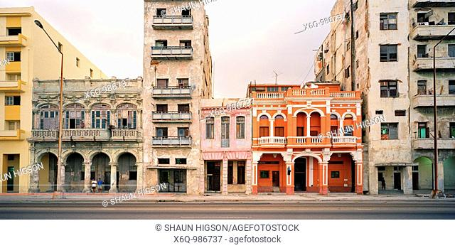 A renovated building amongst other dilapidated buildings on the Malecon in Havana, Cuba