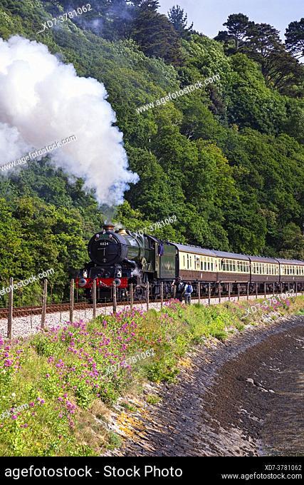 England, Devon, GWR Steam Locomotive No. 6024 'King Edward I' departing from Kingswear heading the Torbay Express