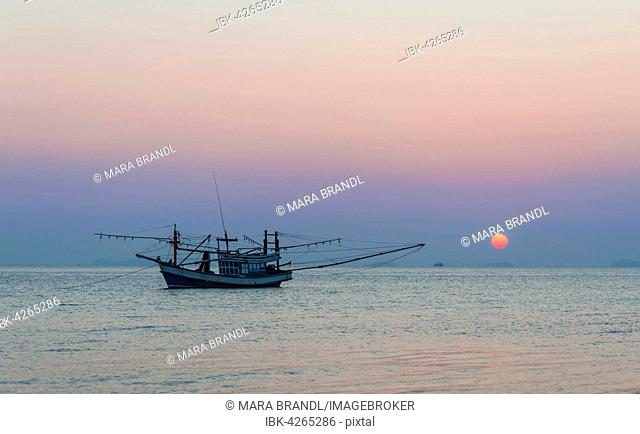 Boat in the sea at sunset, in front of small islands, Koh Samui, Gulf of Thailand, Thailand