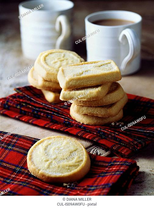 Luxury Scottish all butter shortbread biscuits stacked on tartan tea towel