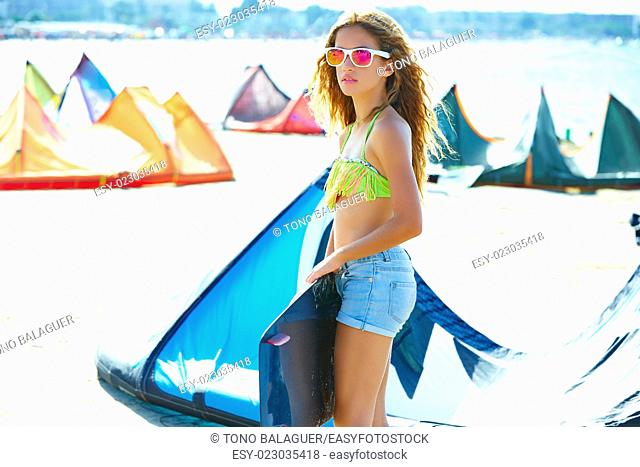 Blond kite surf teen girl in summer beach at Mediterranean