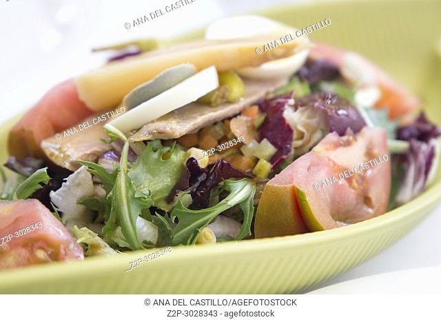 Mediterranean salad on green plate