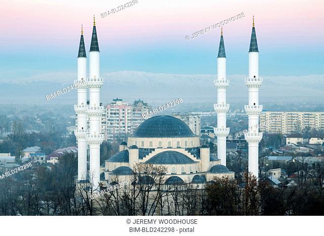 Towers of mosque in cityscape, Bishkek, Frunze, Kyrgyzstan