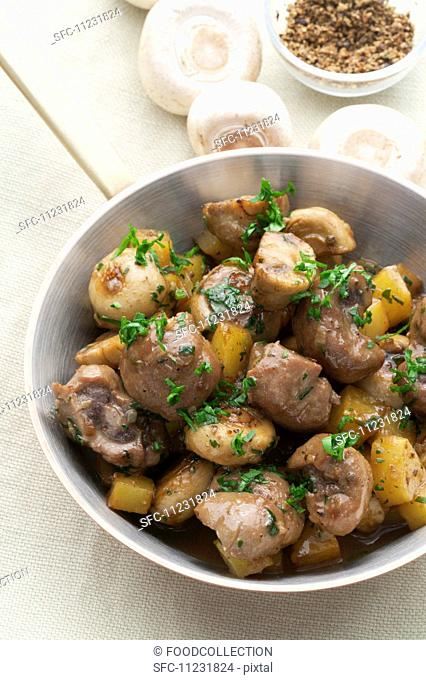 Veal with fresh mushrooms and roast potatoes