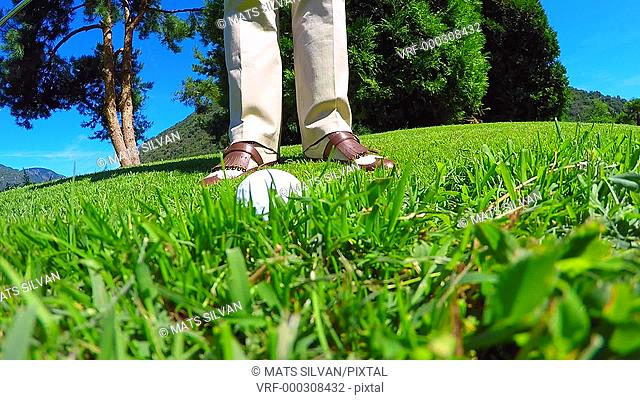 Golfer Chipping the Golf Ball on the Grass in Ticino, Switzerland