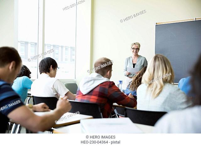 College professor teaching lesson in classroom
