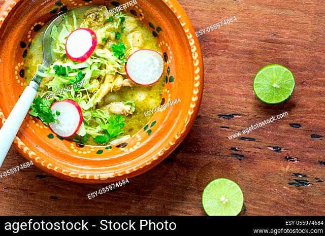 Pozole verde, or green posole is traditionally made with hominy and meat and topped with condiments. Mexican cuisine