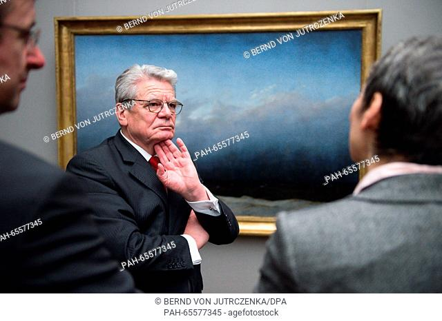 German President Joachim Gauck, and head of the Federal President's Office, David Gill (l), are guided by restorer Kristina Moesl (r) through the special...