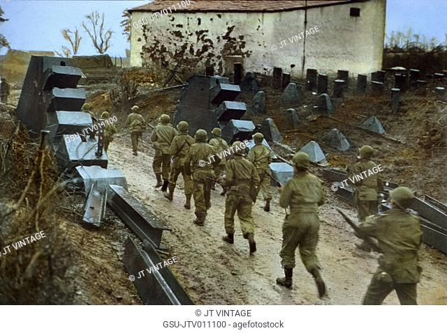Troops Moving Through Dragon's Teeth of West Wall Fortifications, Rhineland Campaign, Germany, 1945