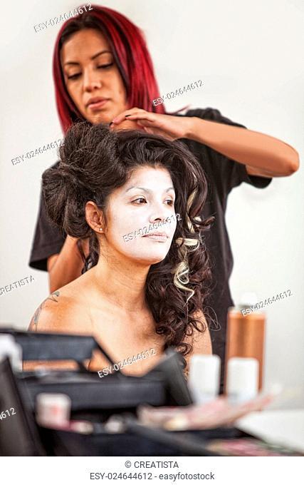 Native American makeup artist working beautiful female performer