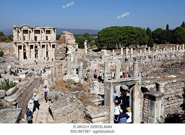 Izmir, Turkey - September, 25th 2011: People visit the library of Celsus in Ephesus city.The library of Celsus is an ancient building in Ephesus, Izmir, Turkey