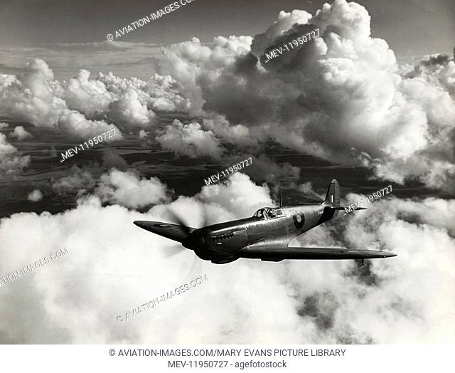 Royal Airforce RAF Photo-Reconnaissance Supermarine Spitfire 11 Flying Enroute with Cloud Behind