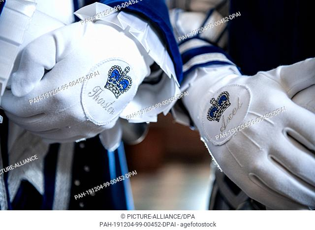 03 December 2019, North Rhine-Westphalia, Mönchengladbach: The gloves of the princes are embroidered with a crown and their name