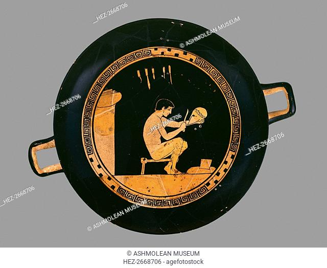 Attic red-figure cup depiting a seated helmet maker and his equipment, c480 BC. Artist: Antiphon Painter