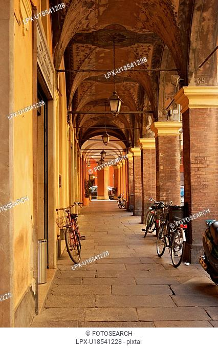 Renaissance portico, fresoed vaulted ceiling with bicycles parked, Modena