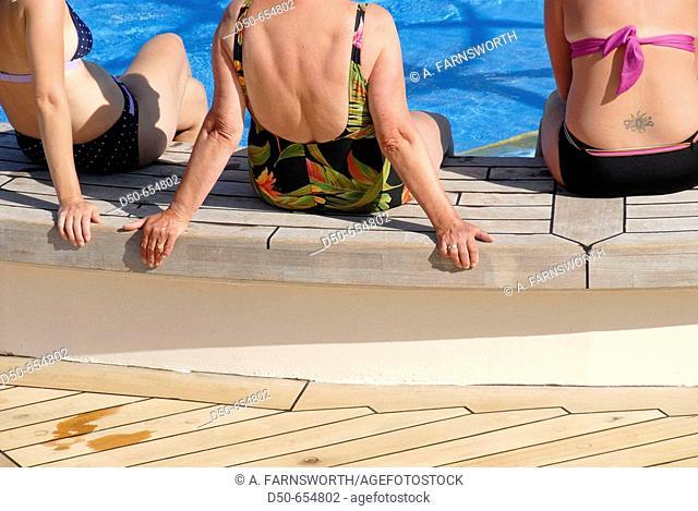 Royal caribbean cruise line. Grandeur of the Seas. Pool deck. Women sitting by the pool