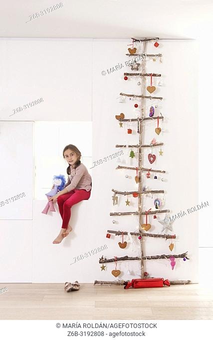 Flat Christmas tree and little girl
