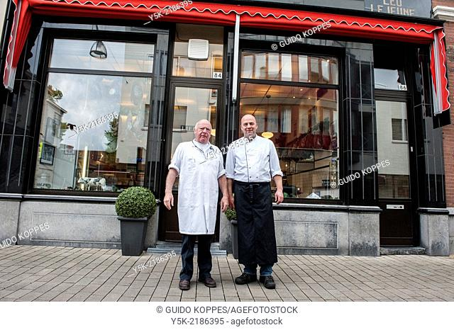 Willem II Straat, Tilburg, Netherlands. Father and son LeJeune are third 3rd and fourth 4th generation butchers at their butchery, established in 1902