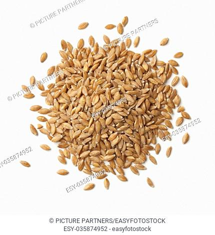 Heap of organic Einkorn wheat seeds on white background