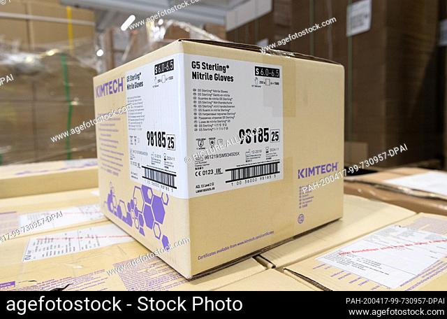 16 April 2020, Brandenburg, Großbeeren: A package of G5 Sterling nitrile gloves is available from the logistics service provider Rhenus Warehousing Solutions SE...