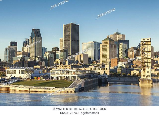 Canada, Quebec, Montreal, city skyline from the St. Lawrence River, dawn