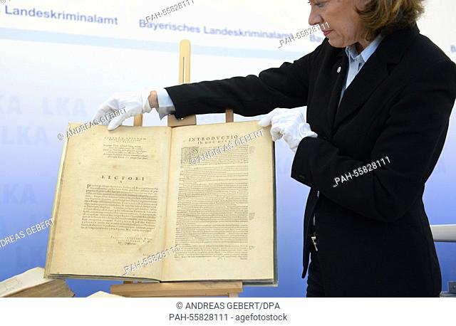 "An employee of the Bavarian State Office of Criminal Investigations shows the book """"Astronomia Nova Aitiologetos"""" (""""New Astronomy"""") by Johannes Kepler"