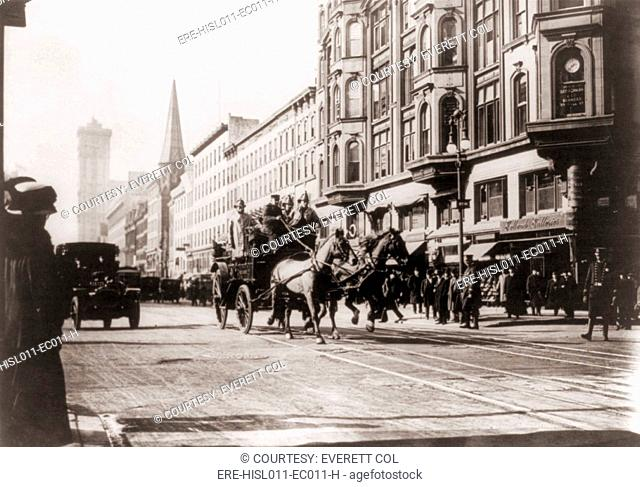 Horse-drawn fire engines in street, on their way to the Triangle Shirtwaist Company fire, New York City. Their ladders extended only to the sixth floor