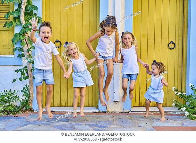 vibrant children jumping together in the air. Australian ethnicity