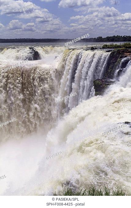 Devils Throat, Iguazu Falls. Iguazu Falls, named after the Guarani word for 'great water', are four times the width of Niagara Falls and are divided by islands...