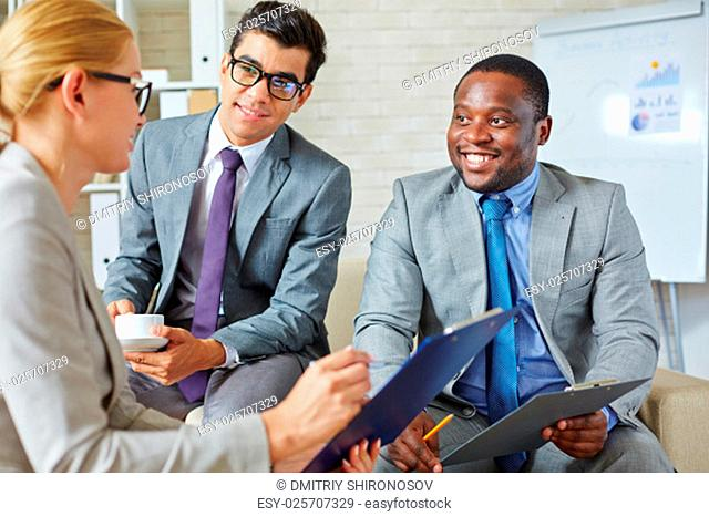 Businessmen persuading a woman into cooperation