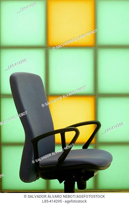 Chair in front of a backlit wall ceramic