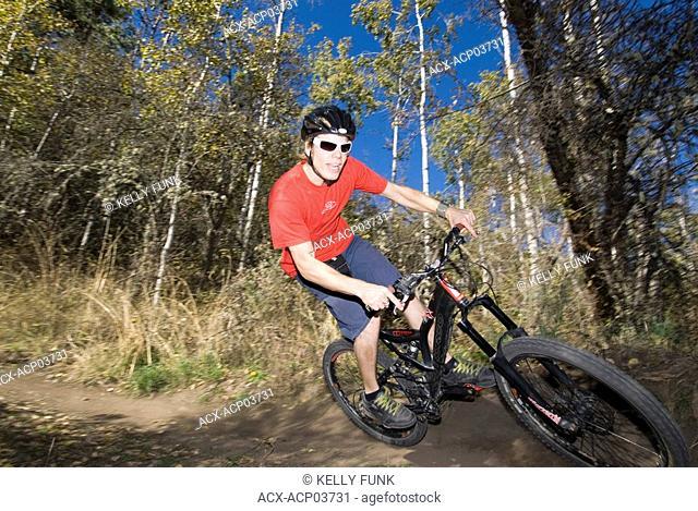Mountain biker racing downhill, British Columbia, Canada
