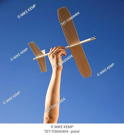 Hand holding toy plane