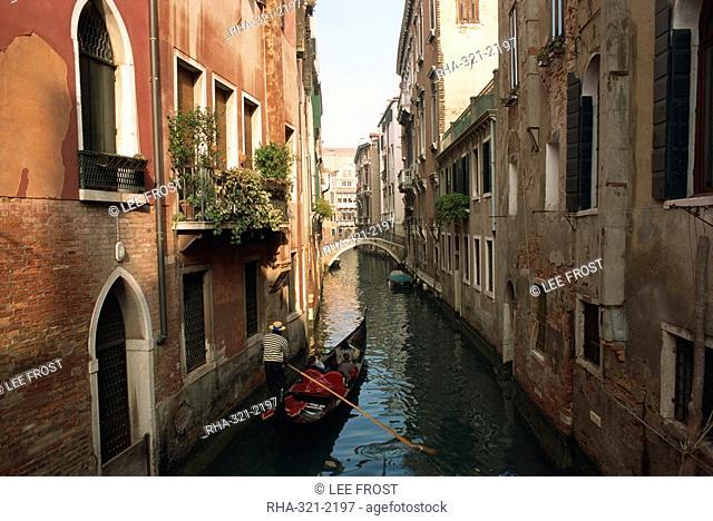 Gondolas on a canal near Piazza San Maria Formosa. Venice, Veneto, Italy, Europe