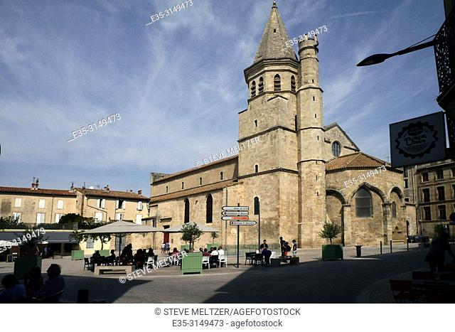 Dining in the Place Madeleine, Beziers, France. Next to the 12th century Church Saint