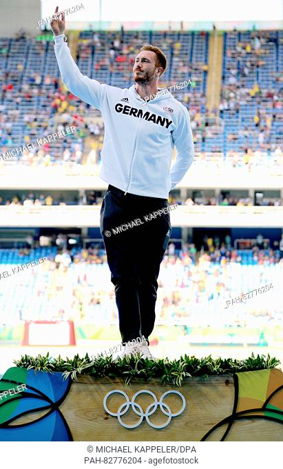 Gold medalist Christoph Harting of Germany celebrates during the medal ceremony after winning the Men's Discus Throw Final of the Athletic