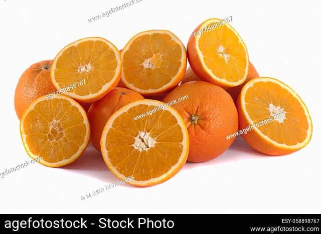Detail view of a bunch of oranges isolated on a white background