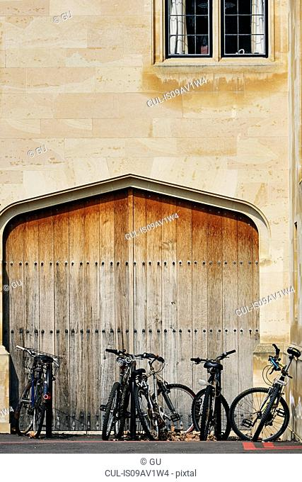 Bicycles parked in doorway, Oxford, UK