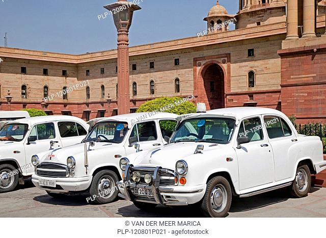 Traditional old fashioned white Indian cars at Rashtrapati Bhavan, official residence of the President of India in New Delhi