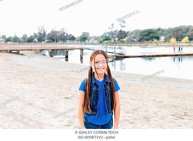 Girl on sandy beach, Long Beach, California, US