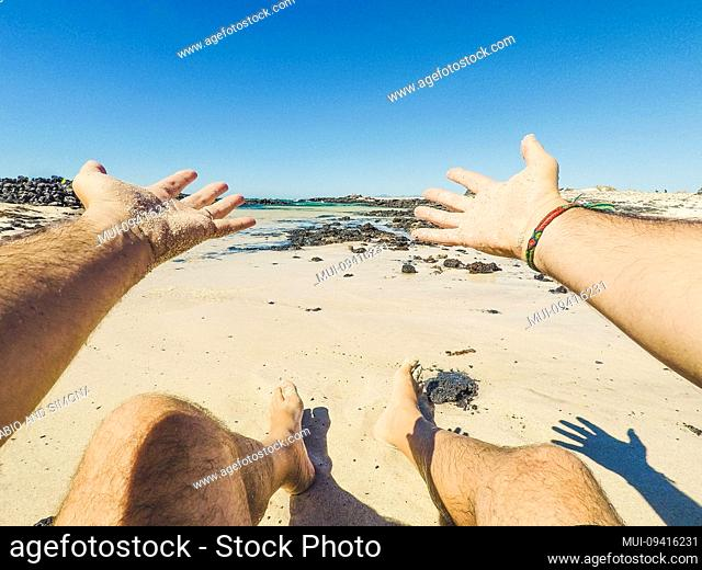 Summer holiday vacation and happiness concept with men eyes point of view of beautiful sandy beach and blue ocean water - happy people in outdoor leisure...