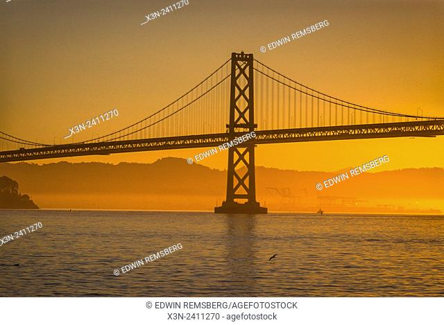 SAN FRANSISCO, CALIFORNIA - Golden Gate Bridge silhouetted at sunset