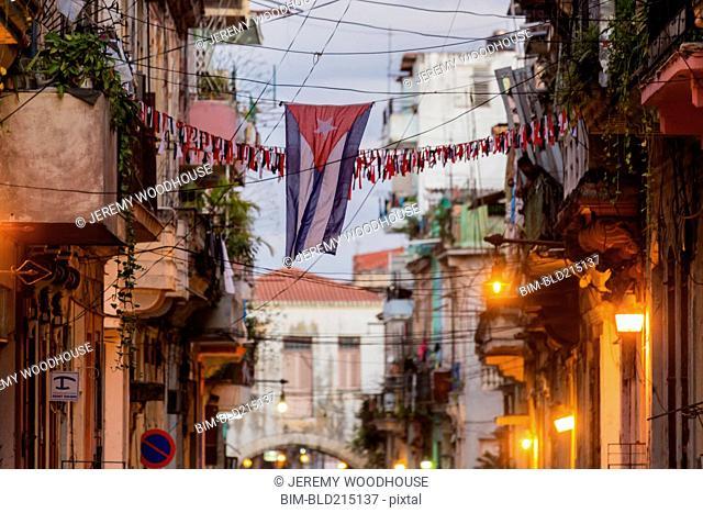 Cuban flag between Havana apartment buildings, Havana, Cuba