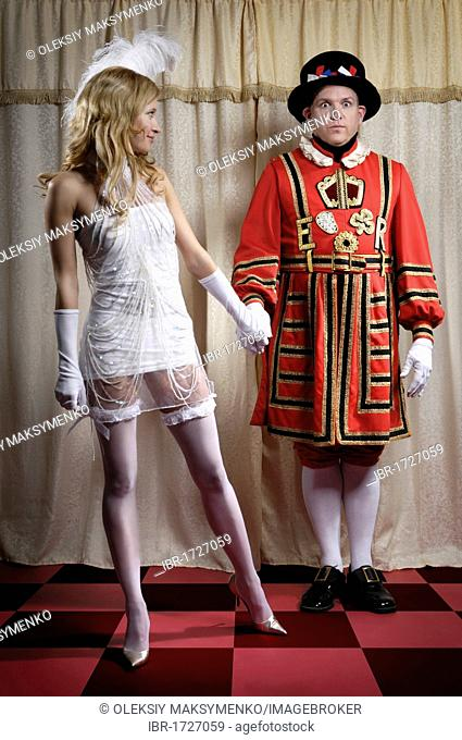 Beautiful young lady trying to distract a Yeoman of the Guard