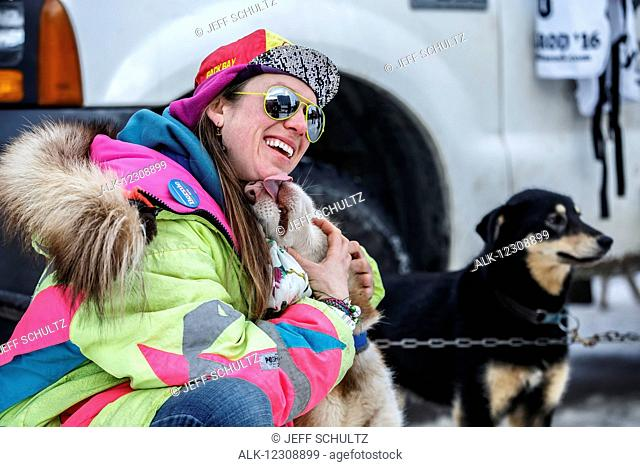 Monica Zappa poses with a dog just prior to the Ceremonial Start of the 2016 Iditarod in Anchorage, Alaska
