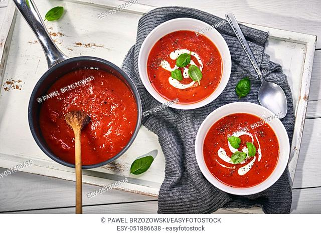 Tomato cream soup with sour cream and basil