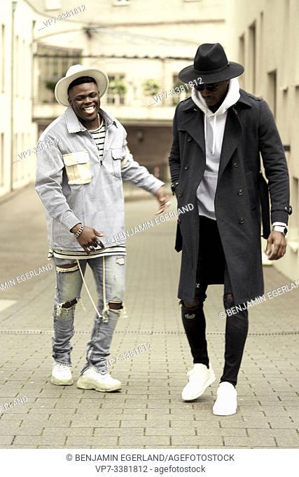 Two men on the street, in Frankfurt, Germany