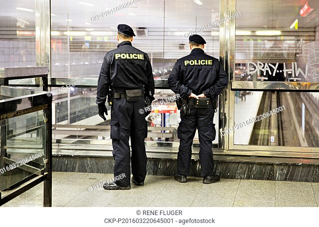 Police officers patrol the Museum metro station in Prague, Czech Republic, Tuesday, March 22, 2016. Authorities in Europe have tightened security at airports